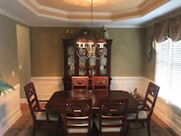 rectangular brown wooden table with chairs and China cabinet dining set Buford, 30519