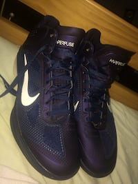 pair of purple Hyperfuse Nike basketball shoes