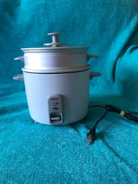 Aroma Rice Cooker With Steamer.  7 cup capacity and comes with operations manual.  Rice come out great every time.  Letting it go because I upgraded to an Insta Pot Cooker. Long Beach, 90804