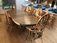 round brown wooden table with four chairs dining set Noblesville, 46060