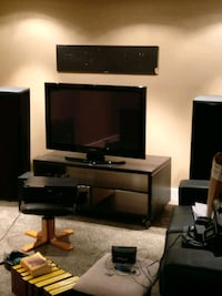 flat screen television and black wooden TV stand Edmonton, T6W 0J4