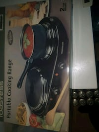 Portable dual burner cooking range