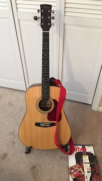 Ibanez acoustic guitar with strap,stand and books. Pemberton township, 08015