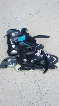 pair of black-and-blue inline skates Monroe