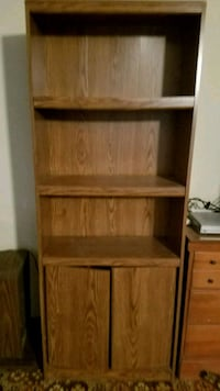 Bookcase with doors on bottom.