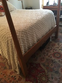 brown wooden bed frame and white mattress 42 km