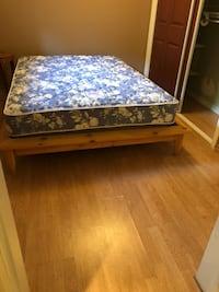 brown wooden bed frame with blue and white floral mattress Montréal, H4M 2W8