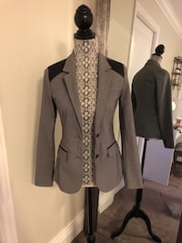 Grey blazer with black shoulder accents