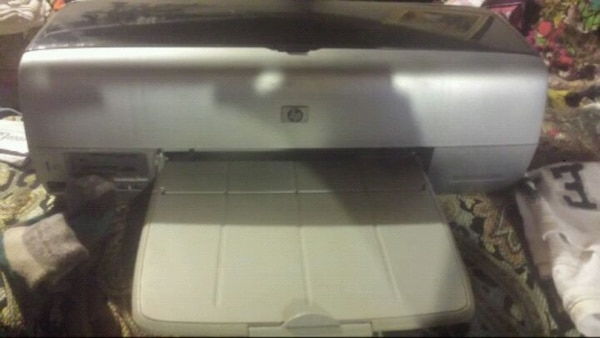 Silver and black HP printer used maybe 3 times