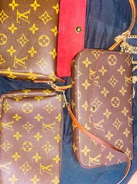 FREE Louis Vuitton pouchette!! With a purchase of $200 or more! Huge sale today! Everything half off!