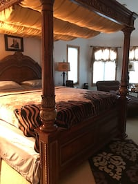 brown wooden bed with post