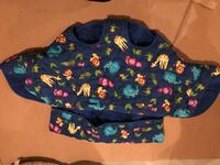 Quilted blue, green, and red animal print cart cover