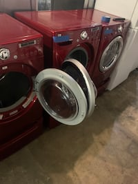 Red  Lg front load washer and dryer with pedestals 4 months warranty