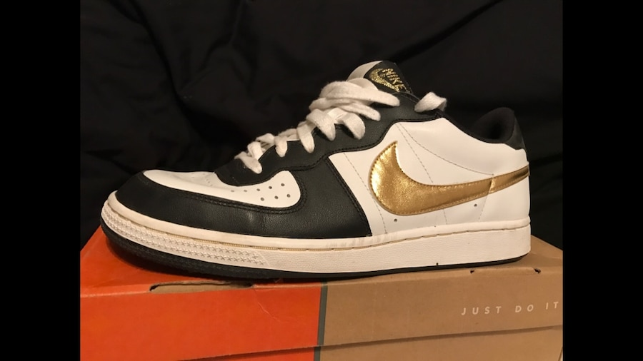 white-black-gold Nike low top sneakers