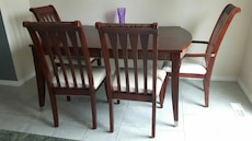 brown wooden table with four parson chairs