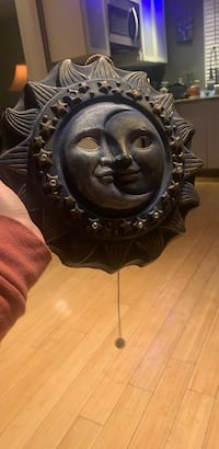 Decorative sun and moon wall decor with music box!