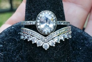 Oval with halo sterling silver wedding set