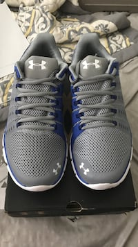 Pair of gray nike running shoes Houston, 77043