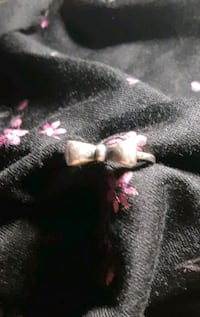 925 bow ring.