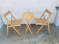 two brown wooden folding chairs Huntington Park, 90255
