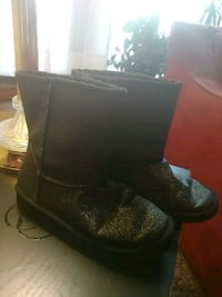 pair of black glittered boots
