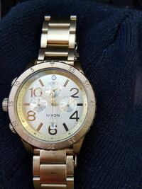 Gold Nixon watch big face