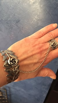 Silver bracelet with chain link to adjustable ring..