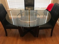 Round glass dining table with 4 new green chairs  Woodbridge, 22192