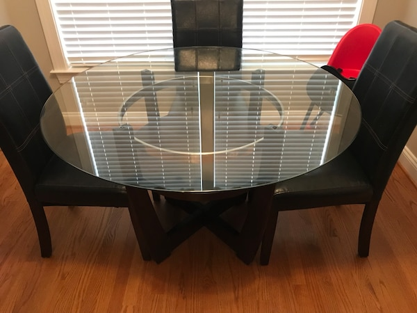 Round glass dining table with 4 new green chairs