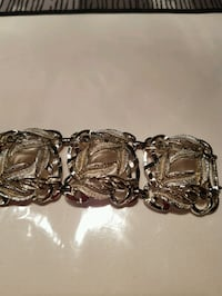 Beautiful Bracelet, silver in color. perfect condi