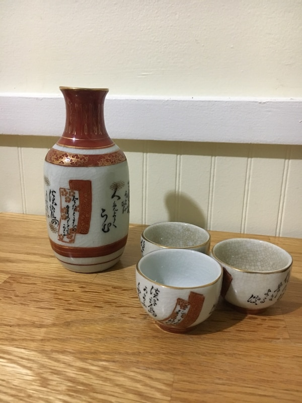 white and brown ceramic pitcher and bowl