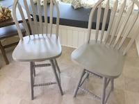 Two gray wood stools