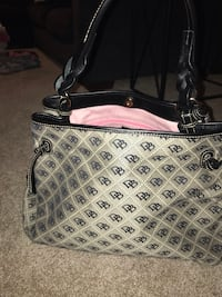 Dooney and Bourke purse. Brand new. Never used 586 mi