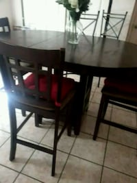 round brown wooden table with four chairs dining set El Paso, 79938