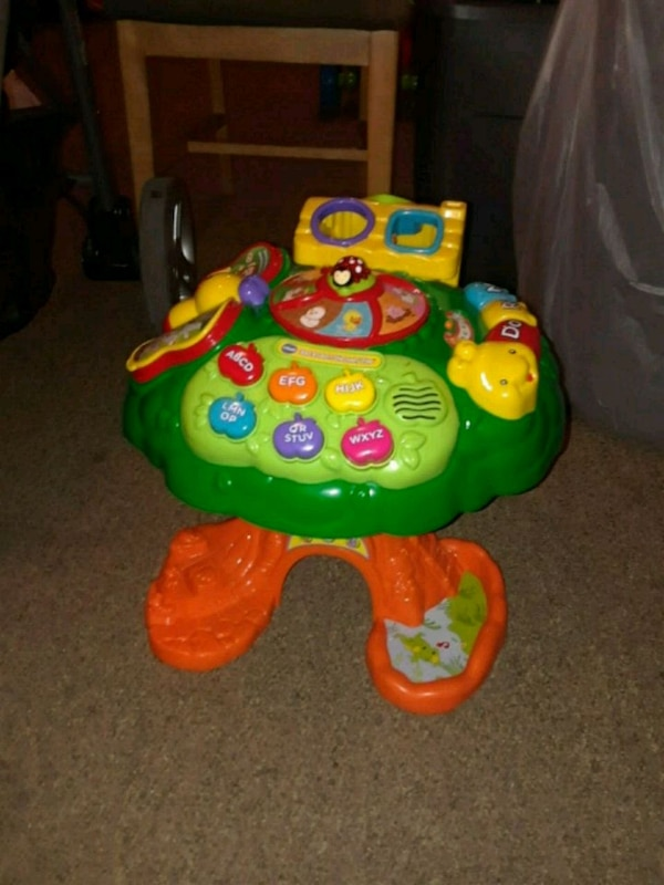 green and orange Fisher-Price learning toy