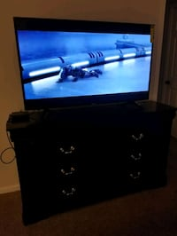 """50"""" TV and chest. Had the chest for a month Las Vegas, 89119"""