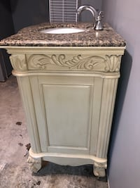 Solid wood vanity sink moving salle you will love it comes with vanity, faucet and sink. Ready to be install.  Hyattsville, 20782