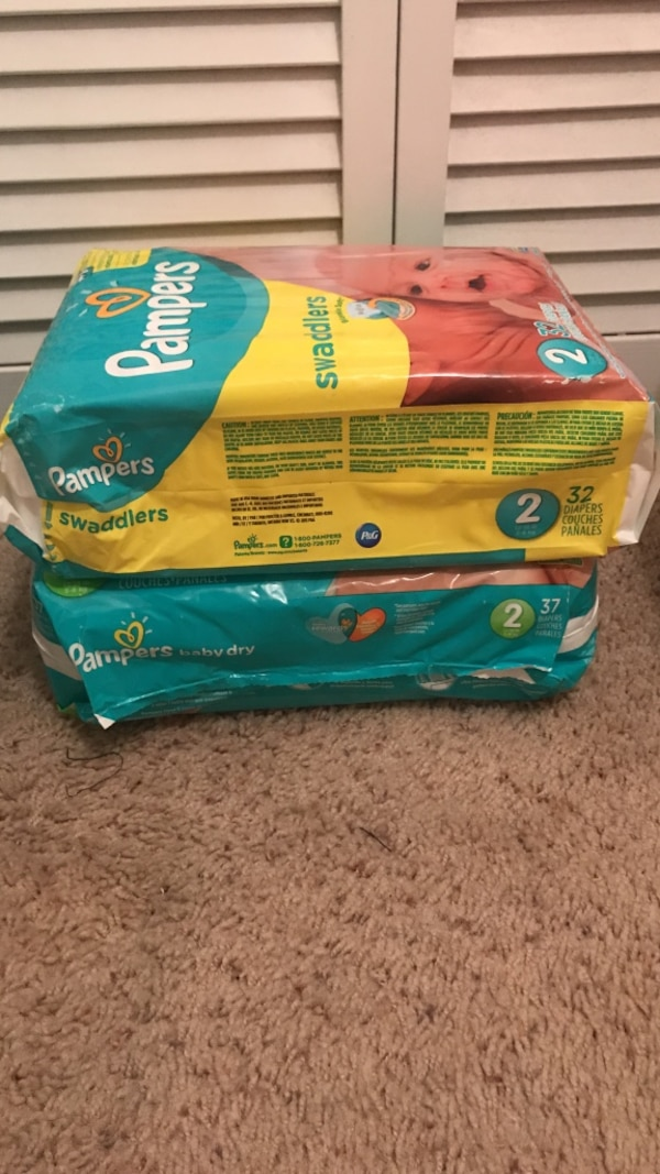 two Pampers Swaddlers diaper packs