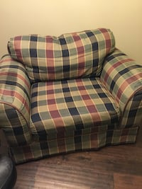 red, grey, and black plaid sofa chair