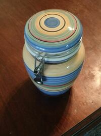 beige and blue ceramic canister