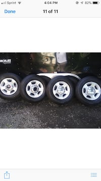 four gray 5-spoke car wheels with tires Manassas Park, 20111