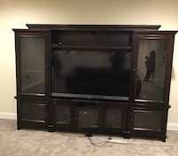 Black flat screen tv with brown wooden tv hutch Washington, 20008