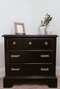 Black night stand with gold hardware