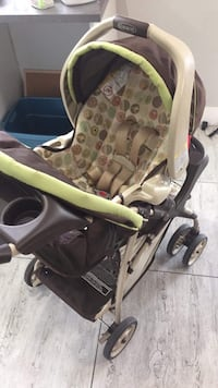 baby's green and black stroller Surrey, V3W 7Z6
