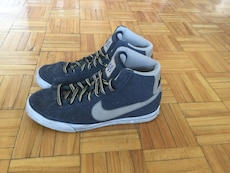 pair of grey Nike basketball shoes