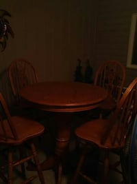 round brown wooden pedestal table with four chairs dining set Windsor, N8S 3N2