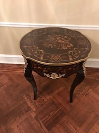 Round brown wooden entry table