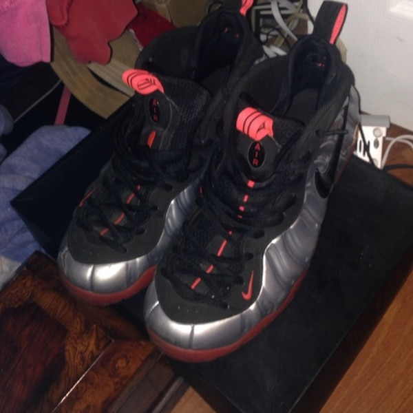 pair of black-and-red Nike Foamposite Size-11.5