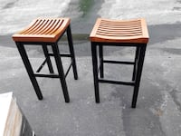Two black-and-brown wooden saddle seat bar stools Middle River, 21220