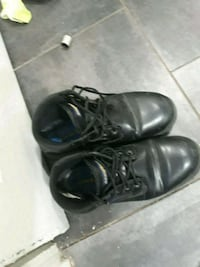 pair of black leather shoes Tucson, 85716